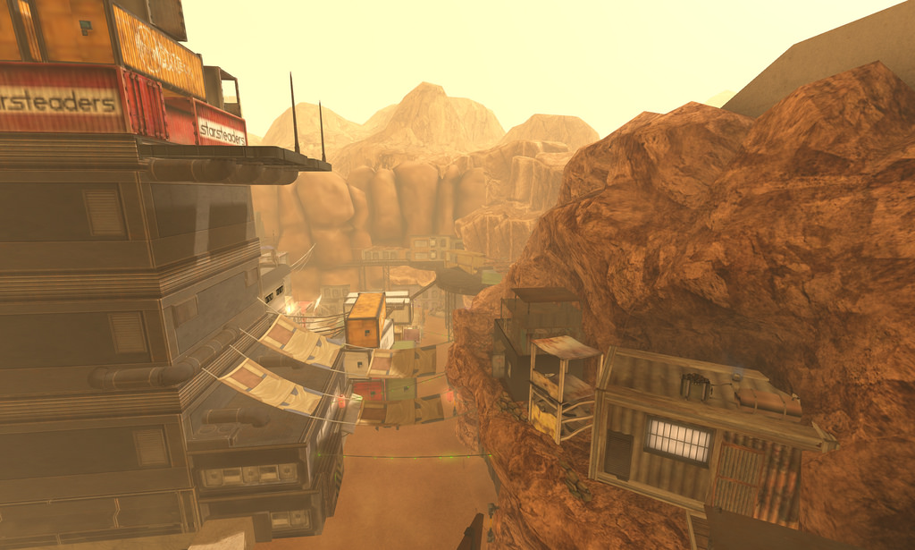 A dusty desert dystopic scene, with houses and store set into cliffs made out of sheet metal and old materials; a hanging line of sheets between a tall building and a rock face provides soemthing like a bridge; a general feeling of poverty brought on by forced isolation.